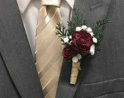 Evergreen Red Maroon Burgundy Babys Breath Boutonniere Wrapped In Gold Ribbon Groomsmen Flowers Prom