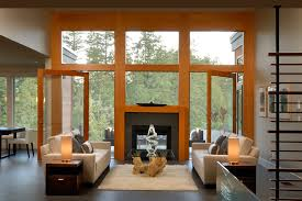 window above fireplace living room rustic with ceiling fan