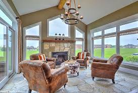 Large Glass Windows And Doors Stone Flooring Shape The Rustic Sunroom From Designing