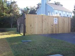 Reed Chain Fenced In Yard Fencing Covers Ugly Chain Link Best Dog ... A Backyard Guide Install Dog How To Build Fence Run Ideas Old Plus Kids With Dogs As Wells Ground Round Designs Small Very Backyard Dog Run Right Off The Porch Or Deck Fun And Stylish For Your I Like The Idea Of Pavers Going Through So Have Within Triyaecom Pea Gravel For Various Design Low Metal Home Gardens Geek To A Attached Doghouse Howtos Diy Fencing Outdoor Decoration Backyards Impressive Curious About Upgrading Side Yard
