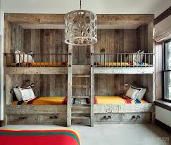 rustic country bunk room features built in barnwood bunk beds