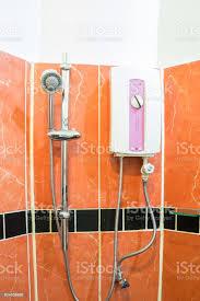 wasserheizung und dusche im badezimmer braun stockfoto und mehr bilder ausrüstung und geräte