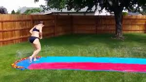 Family Backyard Racing With The Slip And Slide. - YouTube More Accurate Names For The Slip N Slide Huffpost N Kicker Ramp Fun Youtube Triyaecom Huge Backyard Various Design Inspiration Shaving Cream And Lehigh Valley Family Just Shy Of A Y Pool Turned Slip Slide Backyard Racing With Giant 2010 Hd Free Images Villa Vacation Amusement Park Swimming 25 Unique Ideas On Pinterest In My Kids Cided To Set Up Rebrncom Crazy Backyard Slip Slide
