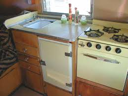 1955 Shasta Trailer With Beautiful Yellow Countertop Fridge And Princess Gas Oven