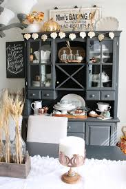 Farmhouse Style Dining Room With Painted Buffet And Hutch Decorated For Fall Neutral Colors
