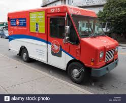 Canada Post Mail Delivery Truck. Montreal, Quebec, Canada Stock ... How To Track Usps Mail Online Youtube Home Of Direct Logistics Truck Freight Postal Fed Ex Smartpost Opiions Page 4 The Ebay Community Package Wars Postal Service Offers Nextday Sunday Delivery Made An Ornament That Displays Package Tracking Updates Updated Australia Post Regular Pority And Express Probably Dont Handle Lost Packages How I Ruced Them California Wildfires Wont Stop Postman From Delivering Mail Your Goin Bellevue Accident In Our Front Yard Vintage Stamps Are The Coolest Way To Send