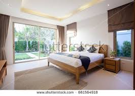 Luxury Interior Design In Bedroom Of Pool Villa With Cozy King Bed High