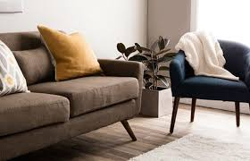 A Low Profile Sofa In Mid Century Modern Living Room