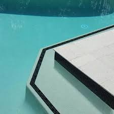 photos of swimming pools fully tiled in ceramic mosaics