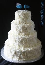 Rustic Elegant Ivory Buttercream Roses Wedding Cake With Blue Lovebirds Topper