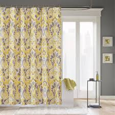 yellow shower curtain with white and gray flowers pattern on the