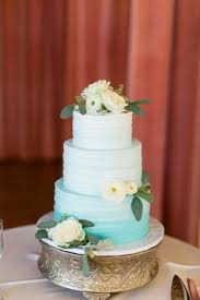 The Thursday Club Blue Ombre Beach Wedding Cake Decorated With White Ranunculus Roses By San