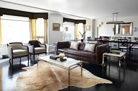 Decorating With Chocolate Brown Couches by Masculine Living Room With Cowhide Rug Dark Brown Leather Sofa