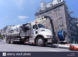 100 Sewer Truck Vactor 2100 Sewer Vacuum Cleaner Truck On Ste Catherine Street Stock