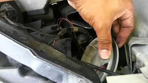 replace 2005 altima driver side headlight bulbs