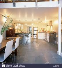 Slate Flooring In Modern Open Plan Dining Room And Kitchen City Loft Conversion