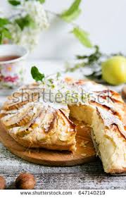 Cutted Apple Pie In Rustic Style On A White Background
