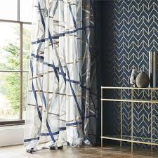 marineblaue tapete mit goldenem geometrischen muster vliestapete blau gold