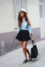 Go For A Chambray Light Blue Shirt And Tuck It Inside Flared Black Mini Skater Skirt Complete This Outfit By Adding Birkenstocks Cool White Panama