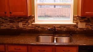 simple kitchen area with subway glass peel stick tile backsplash