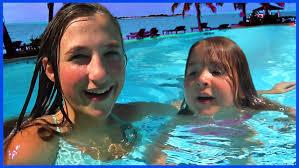Kids Swim In The Swimming Pool