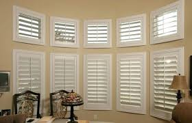 Bay Window Treatments What Makes Shutters The Best Treatment Option Formal Dining Room