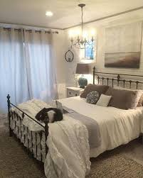 Iron Headboard In A Neutral Guest Room