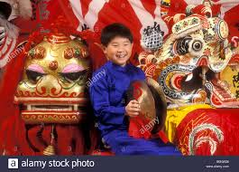 9 year old chinese american boy dressed in traditional clothes for