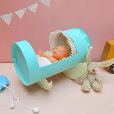 Recycled Oatmeal Container Doll Cradle