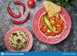 100 Makhany Paneer Makhani Jeera Rice And Paratha In Pink Plate On Dark
