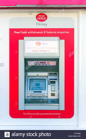 A red UK Post fice ATM providing services by the Bank of Ireland