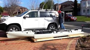 Garage Ceiling Kayak Hoist by Kayak Hobie Tandem Island Hoist Garage Storage To Loading On Car