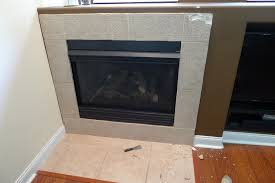 installing new tile around gas fireplace question