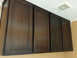 Painting Wall Mounted Oak Kitchen Cabinet With Brown Color
