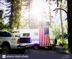An American Flag Hangs At A Campsite With A Truck And A RV Stock ... Lvovnl780onamericantrucksimulator4jpg 20481360 Radiators New And Used Parts American Truck Chrome Volvo Vnl 670 V 12 Simulator Mods Ats Skins Trucks Us Couple Lives The Good Life On Road T680 Harley Davidson Skin For Showrooms Trafico Mexicano Buses Y Trucks 15 Peterbilt 379 Smith Youtube Car Trailer Caravan Mod Bounder 31ft Rv 1986 Beamng Drive Z1 Zinger