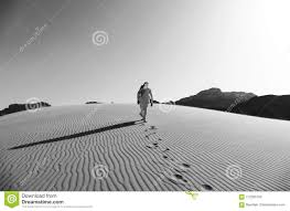 Download Bedouin Walking On The Sand Dunes In Wadi Rum Desert Jordan Black And