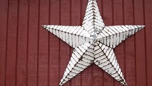 A Close Up Of Rustic Metal Star On The Wall Red Barn