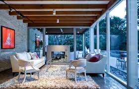 Exposed Wood Beams And Ceiling Lighting With Glass Wall Brick Also Indoor Sunroom