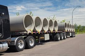 Semi-Trailer Truck Carrying Sewer Pipes; Edmonton, Alberta, Canada ...