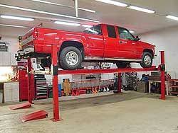 Free standing car lifts designed for the home garage or