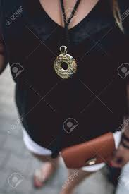 100 The Madalion Gold Medallion Hanging On A Womans Neck On The Medallion Frog
