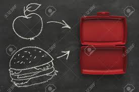 Red Empty Open Plastic Lunch Box For Food Storage On Black Chalk Board With Copy Space