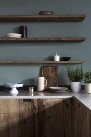 Dark Wood Kitchen Cabinetry With Moody Grey Green Walls And Matching Floating Shelving