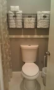 Half Bathroom Decorating Ideas Pinterest by Best 25 Bathroom Towel Storage Ideas On Pinterest Bathroom