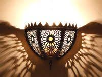 pierced iron moroccan wall light garden walls