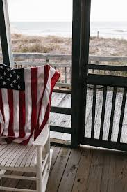 American Flag Draped On Rocking Chair On Porch At Beach ... Costway Outdoor Rocking Lounge Chair Larch Wood Beach Yard Patio Lounger W Headrest 1pc Fniture For Barbie Doll Use Of The Kids Beach Chairs To Enhance Confidence In Wooden Folding Camping Chairs On Wooden Deck At Front Lweight Zero Gravity Rocker Backyard 600d South Sbr16 Sheesham Relaxing Errecling Foldable Easy With Arm Rest Natural Brown Finish Outdoor Rocking Australia Crazymbaclub Lovable Telescope Casual Telaweave