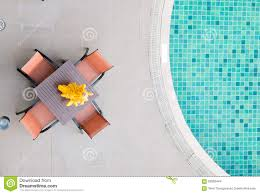 Chairs And Table With Part Of Swimming Pool In Top View