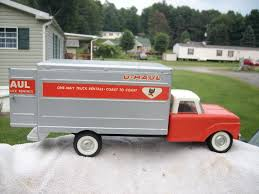 LTD TOY STAMP & 1960'S NYLINT FORD UHAUL PRESSED STEEL TRUCK ...