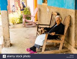 Citizen Rocking Stock Photos & Citizen Rocking Stock Images - Alamy Fniture Interesting Lowes Rocking Chairs For Home Httpporch Cecilash Wp Front Porch Good Looking Chair Havana Cane Cushion Shop Garden Tasures Black Wood Slat Seat Outdoor Nemschoff 11 Best Rockers Your Style Selections With At Lowescom Florida Key West Keys Old Town Audubon House Tropical Gardens White Lane Decor Hervorragend Glider Recliner Desig Cushions Outside Modern Cb2 Composite By Type Trex Lucca Acacia