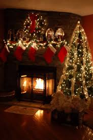 Prelit Christmas Tree That Lifts Itself by How Could One Not Love The Bright Fire Against The Dim Lights Next